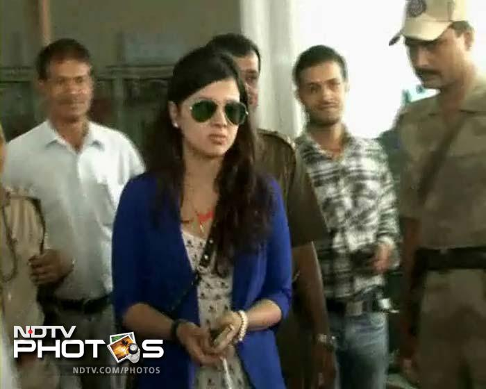 Mrs Sakshi Dhoni being escorted to her car as she walks behind MS.