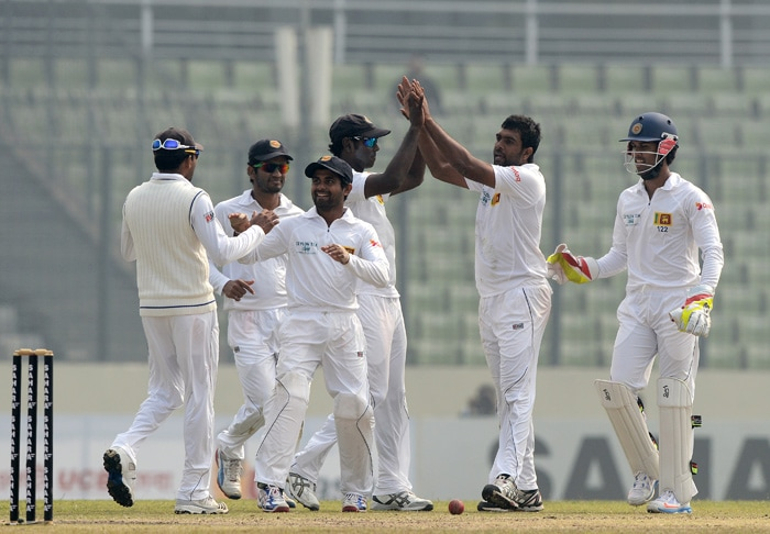 Sri Lanka beat Bangladesh by an innings and 248 runs in the first Test at Mirpur on Thursday to take a 1-0 lead in the 2-match series. (All images from AP and AFP)
