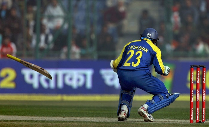 Tillakaratne Dilshan's bat falls while taking evasive action after a ball from Nehra hit him during the final ODI between India and Sri Lanka at Ferozshah Kotla stadium, in New Delhi on Sunday. (PTI Photo)