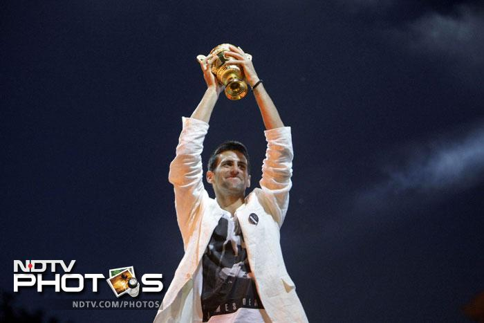 Novak Djokovic received a rapturous welcome in Serbia following his triumph at Wimbledon and on his first day as the world's top-ranked tennis player.