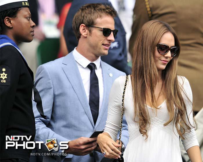 British Formula One driver Jenson Button (L) was in the stands to watch the final along with partner Jessica Michibata. (AFP PHOTO)