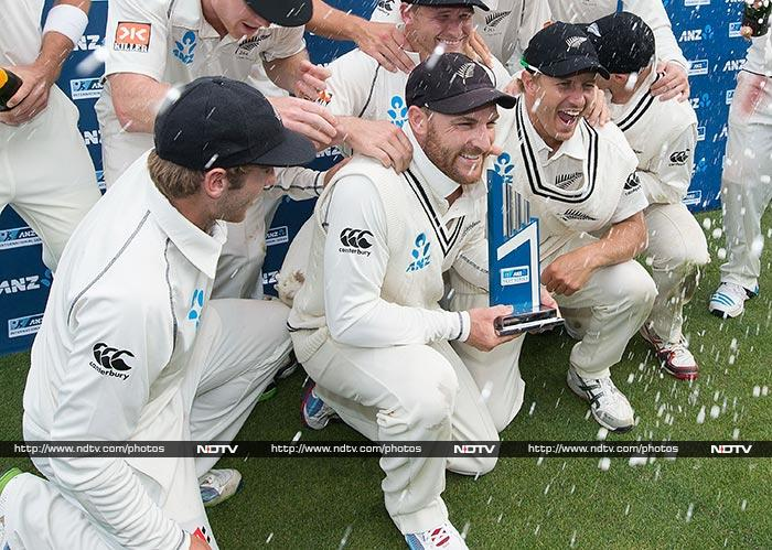 The team poses with the trophy and the joy is evident from their expressions, especially that of skipper Brendon McCullum.