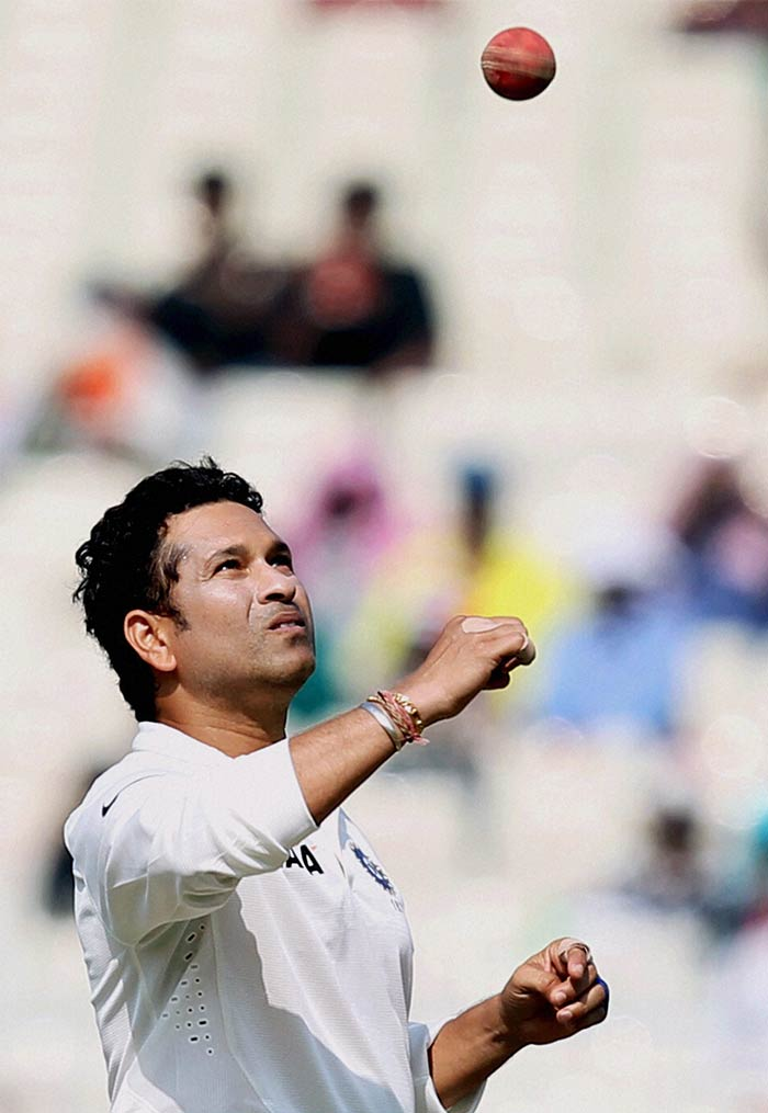 After MS Dhoni used all of his four frontline bowlers in order to end the second-wicket stand between Kieran Powell and Darren Bravo, he turned to the 'man with the golden arm' Sachin Tendulkar on Day 3 of the first Test between India and West Indies at the Eden Gardens, Kolkata on Thursday. Image courtesy: PTI