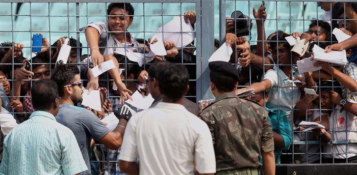 Virat Kohli is signing autographs as hundreds of fans queued up to watch the Indian team practice at the Eden Gardens, ahead of the first Test against the West Indies. People came from far and wide as they have one last chance to see Sachin Tendulkar play an international game at the iconic venue.