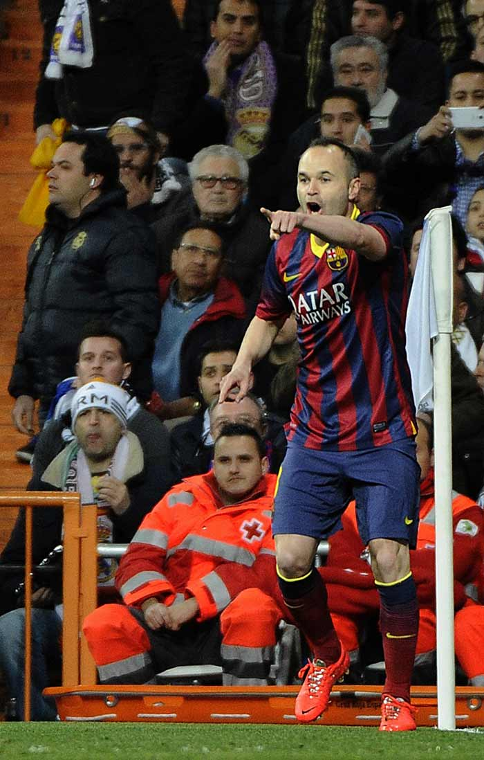 The game got off to a blistering start as after Neymar and Benzema had early efforts easily saved, Barca opened the scoring when Messi played in Andres Iniesta (in pic) behind the Real defence and the Spanish international smashed the ball in off the underside of the bar.