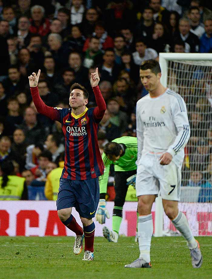 Barcelona moved to within a point of Real Madrid at the top of La Liga as they twice came from behind thanks to a Lionel Messi hat-trick to edge a thrilling El Clasico 4-3 at the Santiago Bernabeu. (All images from AFP)