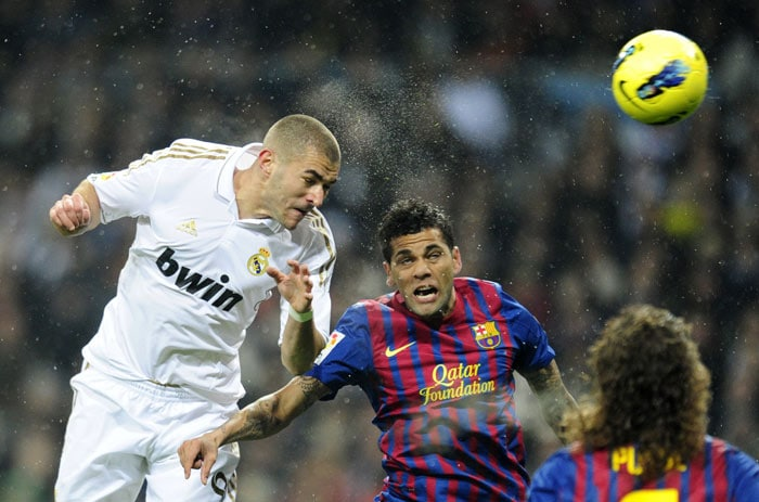 French striker Karim Benzema scored the early goal to give Real a 1-0 lead after a terrible clearance from Barcelona goalkeeper Victor Valdes.