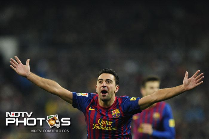 A drive from Xavi in the 53rd minute took a wicked deflection off Marcelo and beyond the desperate reach of Iker Casillas in the Real goal as Barcelona went into a 2-1 lead.