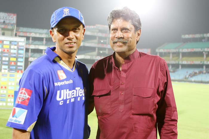 A smiling Rahul Dravid poses with 1983 World Cup winning captain Kapil Dev after his team Rajasthan Royals completed a 4-wicket win over Hyderabad on Wednesday, May 22, 2013. (BCCI image)