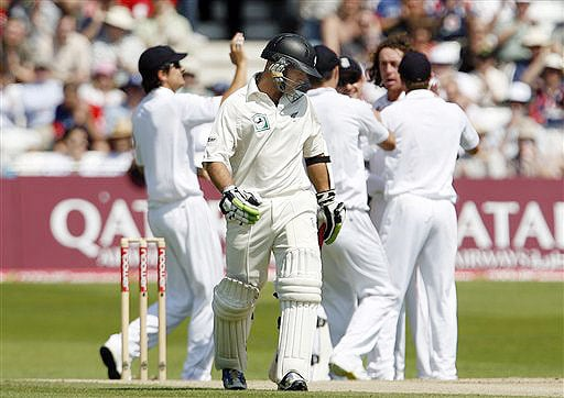 New Zealand's Gareth Hopkins reacts by looking at the pitch as he walks back to the dressing room as England celebrate his wicket on the fourth day of the third Test Match at Trent Bridge Stadium in Nottingham on June 8, 2008.