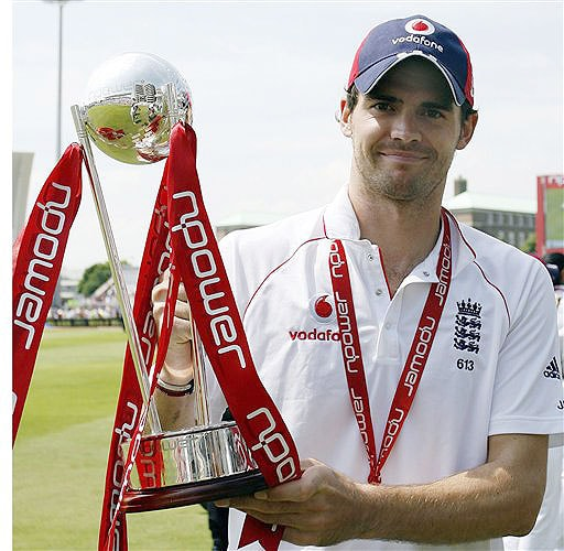 England's James Anderson, who was man of the match, celebrates with the npower trophy after defeating New Zealand on the fourth day of the third Test Match at Trent Bridge Stadium in Nottingham on June 8, 2008.