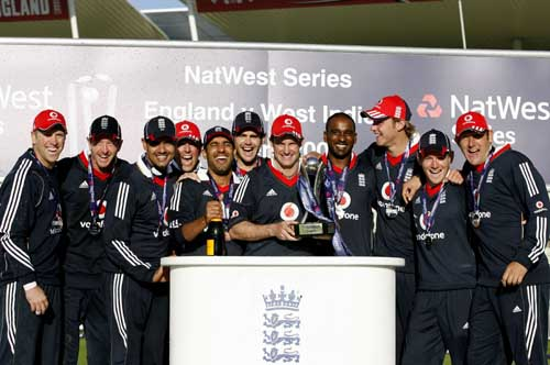 England captain Andrew Strauss holds the trophy celebrating their win in the One-Day International against the West Indies at Edgbaston cricket ground in Birmingham. (AFP Photo)