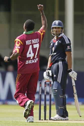 Ravi Bopara is bowled for 49 runs by West Indies bowler Dwayne Bravo during the third Nat West One-Day International in Birmingham. (AFP Photo)