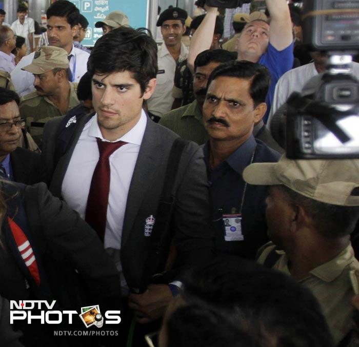 England cricket team captain Alastair Cook, center, arrives with his team at the airport. (AFP Photo)