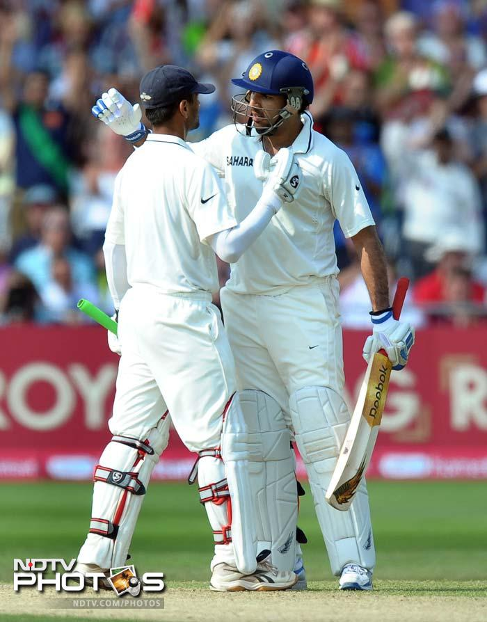 India's Rahul Dravid (L) celebrates 100 runs not out with India's Yuvraj Singh during the second day of the second cricket Test match at Trent Bridge. (AFP Photo)