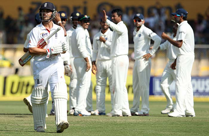 It was then Pragyan Ojha's turn to push for a man-of-the-match award. He first took Jonathan Trott's wicket with a peach of a delivery. Trott, trotted off with a wry smile on his face for some unknown reason. Indian team and fans were sensing something. The stadium was abuzz then. (Photo credit: BCCI)