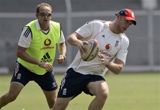 Andrew Flintoff (right) runs with a rugby ball, as assistant coach Andy Flower chases him during a practice session in Mumbai on Saturday, November 8, 2008. (AP Photo)