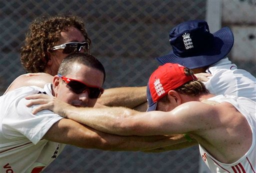 Kevin Pietersen (left) exercises with teammate Paul Collingwood during a practice session in Mumbai on Friday, November 7, 2008. The England team is in India to play seven one-day international and two Test cricket matches against host India beginning Nov 14. (AP Photo)