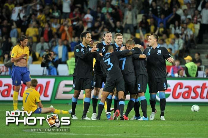 England remained on course for a place in the knockout rounds of Euro 2012 after coming from behind to send Sweden crashing out of the tournament with a 3-2 victory on Friday. (All AFP and AP Images)
