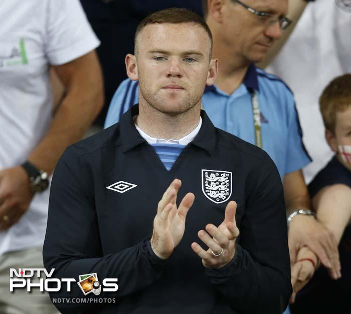 Suspended England striker Wayne Rooney was there to cheer for his team. He and the English team will be relieved that Rooney can finally play the next game after having served his two-match suspension.