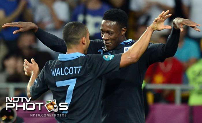 Theo Walcott darted into the box with an electrifying burst to cross for Danny Welbeck, who flicked in a deft finish with the back of his heel to make it 3-2.