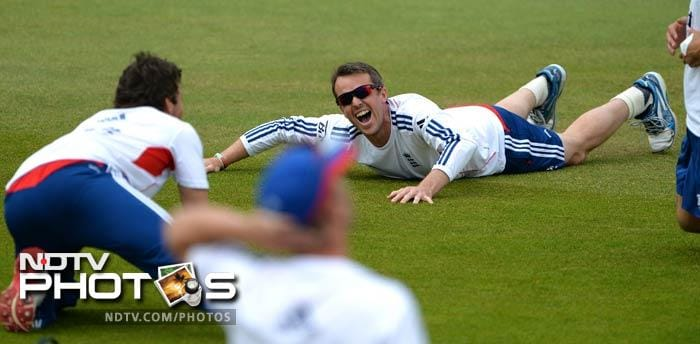Graeme Swann has a laugh with his mates as he does some stretching on the field. The team keeps an informal calm among themselves as they get set to take on their arch-rivals.