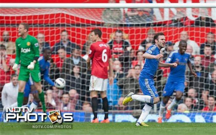 Juan Mata squeezed home an 87th-minute winner as Chelsea beat already-crowned champion Manchester United 1-0 to boost their hopes of qualifying for the Champions League.