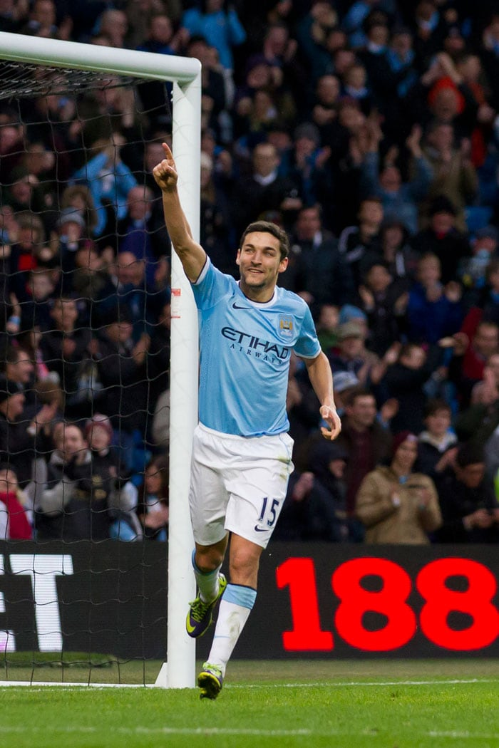 Manchester City's Jesus Navas celebrates after scoring his side's sixth goal against Tottenham during their English Premier League match at the Etihad Stadium.