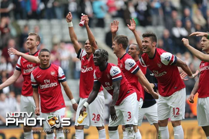 A 1-0 win for Arsenal over Newcastle sealed the final qualifying spot for the Champions League and forced Tottenham to settle for a Europa League place.