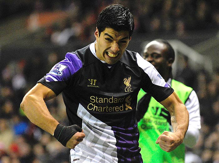 Luis Suarez scored his 21st and 22nd goals of the season as Liverpool claimed a thrilling 5-3 victory at Stoke City.
