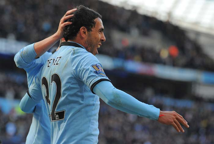 Carlos Tevez (in pic) and Vincent Kompany were the other scorers while an own goal from James Perch further added to City's dominance.