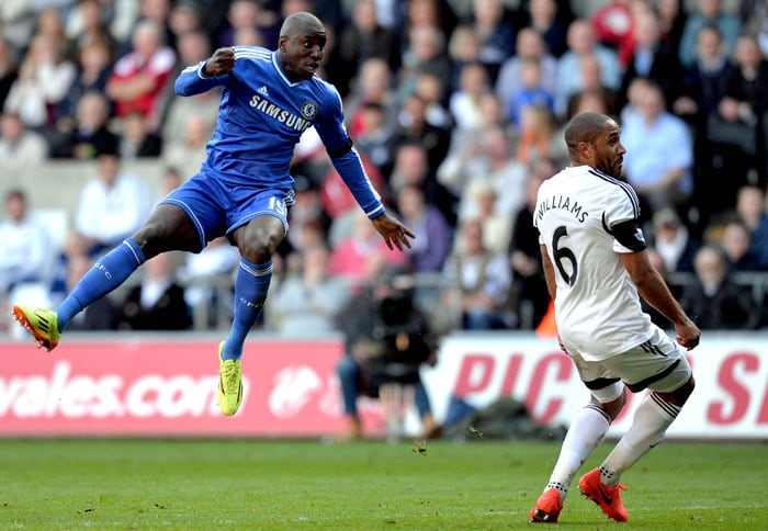 Demba Ba scored the only goal of the scrappy encounter between Chelsea and Swansea to keep the former alive in the title race (All images AFP).