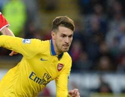 Photo : EPL: Ramsey brace sends Arsenal seven clear, West Ham hammer Fulham