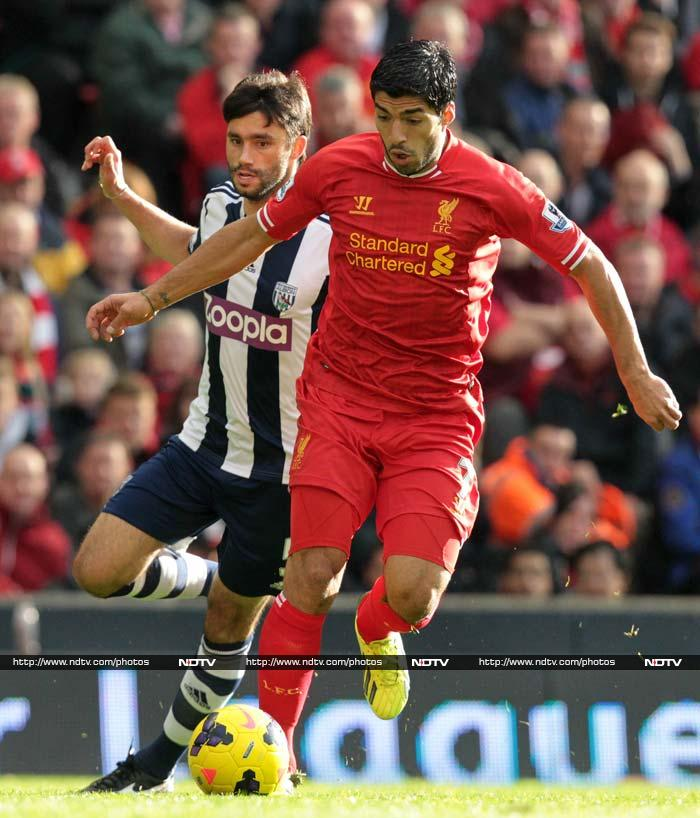 Luis Suarez fired a hat-trick as Liverpool moved up to second place in the Premier League with a 4-1 rout of West Bromwich Albion on Saturday. Uruguay forward Suarez struck twice early in the first half at Anfield and completed his treble soon after half-time.