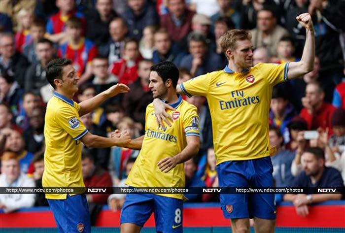 Mikel Arteta scored and was then sent off as Arsenal edged Crystal Palace 2-0 at Selhurst Park to maintain their top spot in the Premier League. (All AP and AFP images)