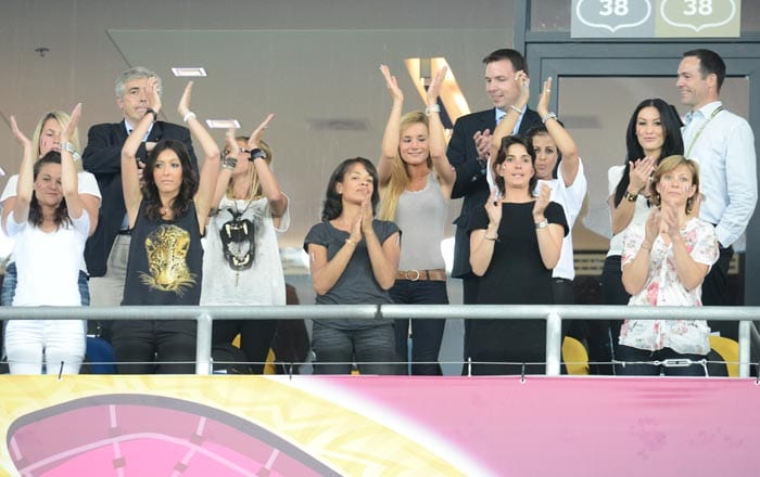 Claire Koscielny, Ludivine Debuchy, Jennifer Giroud, Fiona Cabaye, Florencia Malouda (C), Wahiba Ribery and Sidonie Biemont (girlfriend of Adil Rami) in a VIP box prior to the start of the Euro 2012 football championships match between Sweden and France on June 19, 2012 at the Olympic Stadium in Kiev. (AFP Photo)
