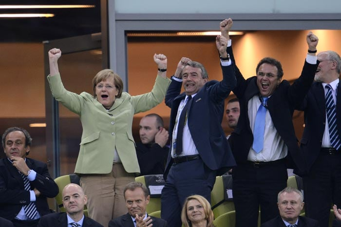 German Chancellor Angela Merkel and German football association president Wolfgang Niersbach celebrate after Germany scored during the Euro 2012 football championships quarter-final match against Greece on June 22, 2012 at the Gdansk Arena. (AFP Photo)