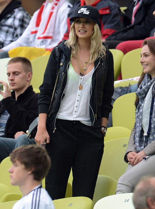 Lena Gercke, girlfriend of German midfielder Sami Khedira, during the Euro 2012 football championships quarter-final match between Germany and Greece on June 22, 2012 at the Gdansk Arena. (AFP Photo)