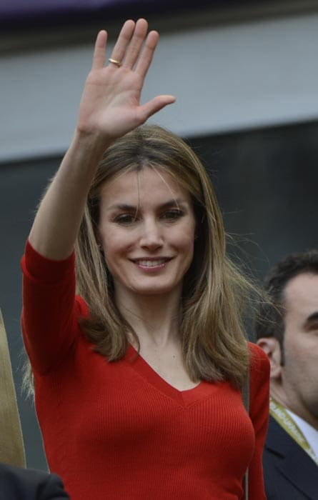 Princess Letizia waves before the start of the Euro 2012 match between Spain and Italy. (AFP Photo)