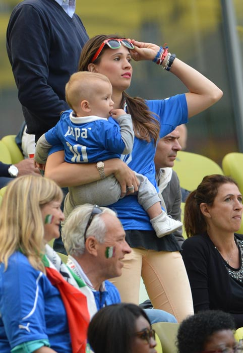 Italian forward Antonio Cassano's girlfriend and son wait in the grandstand prior to the match between Spain and Italy. (AFP Photo)