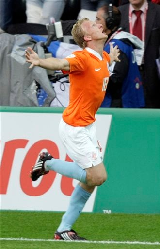 Netherlands' Dirk Kuyt celebrates after opening the scoring during the group C match between the Netherlands and France in Bern on June 13, 2008.