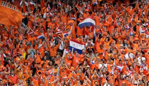 Dutch fans celebrate during the group C match between the Netherlands and France in Bern on June 13, 2008.
