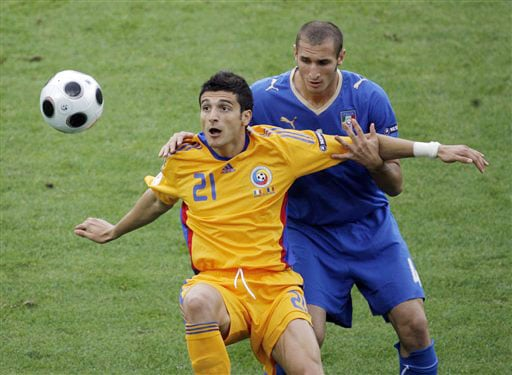 Romania's Daniel Niculae, foreground, holds back Italy's Giorgio Chiellini during the group C match between Italy and Romania in Zurich on June 13, 2008.