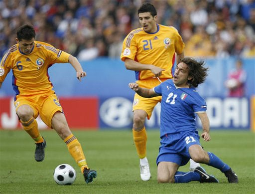 Italy's Andrea Pirlo, right, challenges for the ball with Romania's Mirel Radoi, left, and Daniel Niculae during the group C match between Italy and Romania in Zurich on June 13, 2008.