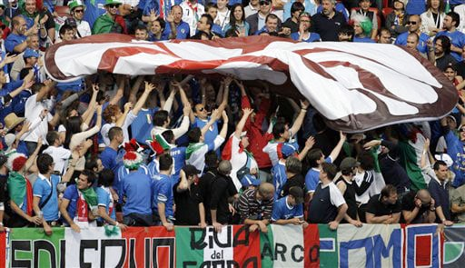 Italian fans unfolds a flag prior to the group C match between Italy and Romania in Zurich on June 13, 2008.