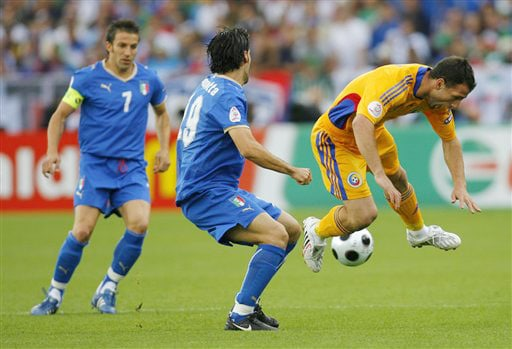 Romania's Razvan Rat, right, is challenged by Italy's Gianluca Zambrotta, center, as Italy's Alessandro Del Piero, left, looks on during the group C match between Italy and Romania in Zurich on June 13, 2008.