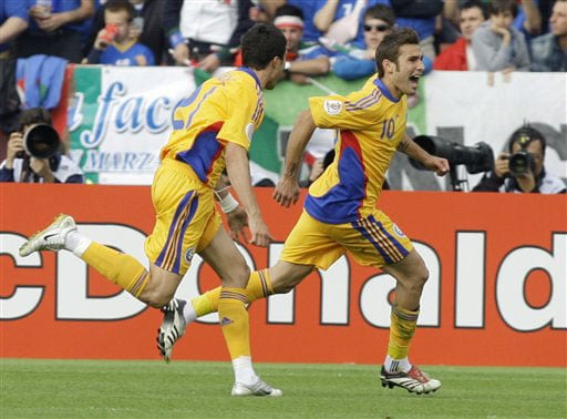 Romania's Adrian Mutu, right, celebrates scoring the opening goal during the group C match between Italy and Romania in Zurich on June 13, 2008.