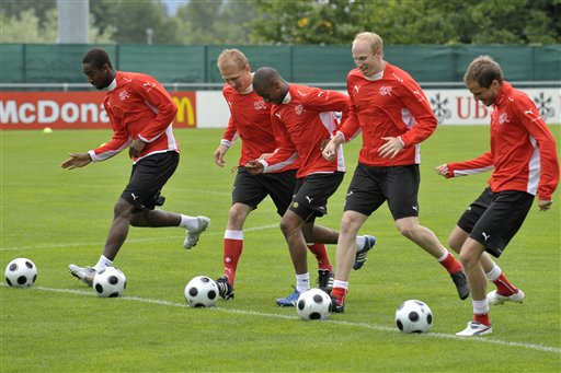 Swiss national soccer players Johan Djourou, Stephane Grichting, Gelson Fernandes, Ludovic Magnin and Patrick Mueller, from left, play balls during a training session ahead of the Euro 2008 Soccer Championships in Freienbach, Switzerland on Wednesday, June 4, 2008. Switzerland plays in group A at the Euro 2008 European Soccer Championships.