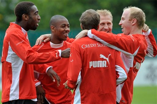 Swiss national soccer players Johan Djourou, Gelson Fernandes, Patrick Mueller, Stephane Grichting and Ludovic Magnin, from left, have fun during a training session ahead of the Euro 2008 Soccer Championships in Switzerland on Wednesday, June 4, 2008. Switzerland plays in group A at the Euro 2008 European Soccer Championships.