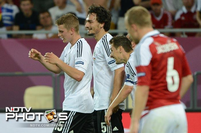 The win meant Denmark were out of the tournament and the Germans were unbeaten and at the top of their group. Just the tonic they needed as they gear up for the knock out phase of Euro 2012. (AFP Photo)